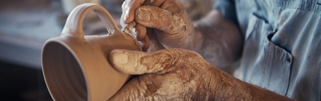 picture of man wich work with clay